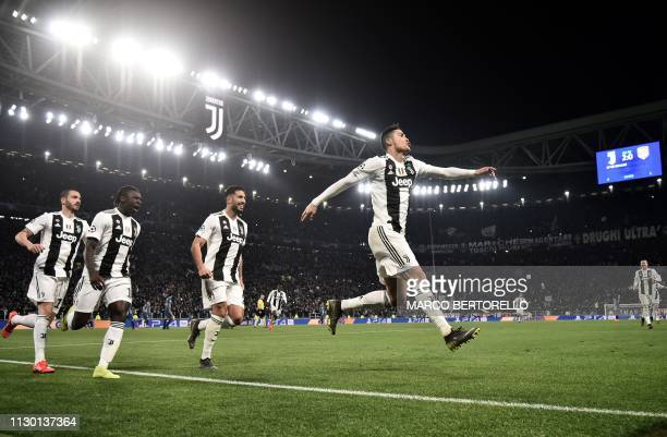 Juventus' Portuguese forward Cristiano Ronaldo celebrates after scoring 30 during the UEFA Champions League round of 16 secondleg football match...