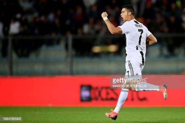Juventus' Portuguese forward Cristiano Ronaldo celebrates after scoring a goal during the Italian Serie A football match between Empoli and Juventus...