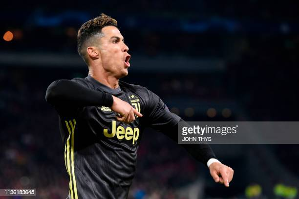 TOPSHOT Juventus' Portuguese forward Cristiano Ronaldo celebrates after scoring a goal during the UEFA Champions League first leg quarterfinal...