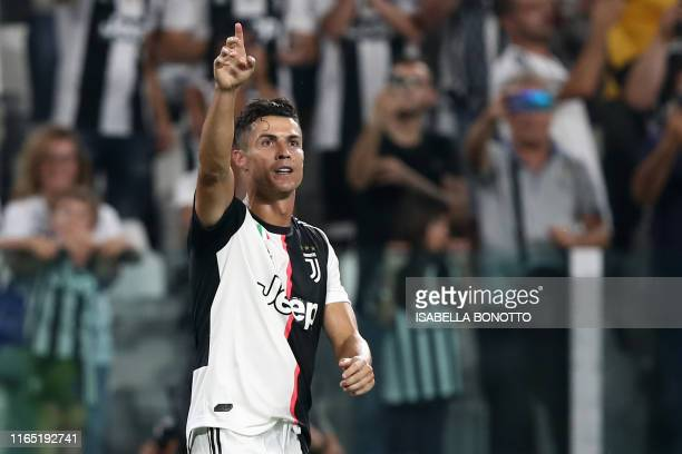 Juventus' Portuguese forward Cristiano Ronaldo celebrates after scoring a goal during the Italian Serie A football match Juventus vs Napoli on August...
