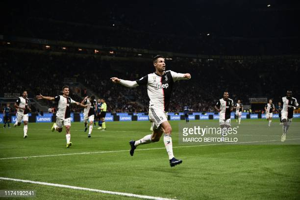 Juventus' Portuguese forward Cristiano Ronaldo celebrates after scoring a goal that was later rescinded during the Italian Serie A football match...