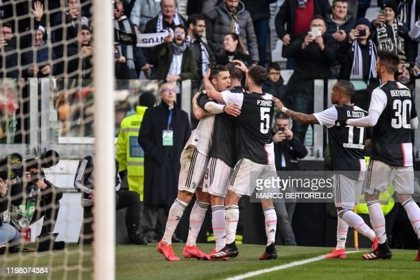Juventus' Portuguese forward Cristiano Ronaldo celebrates after scoring a penalty during the Italian Serie A football match Juventus vs Fiorentina on...