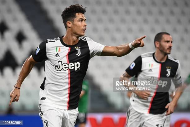 Juventus' Portuguese forward Cristiano Ronaldo celebrates after scoring a penalty during the Italian Serie A football match Juventus Turin vs...