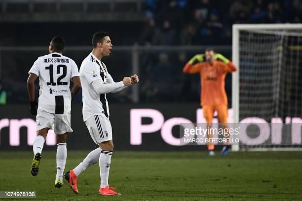 Juventus' Portuguese forward Cristiano Ronaldo celebrates after scoring an equalizer during the Italian Serie A football Match Atalanta Bergamo vs...
