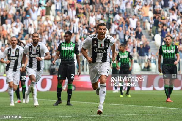 Juventus' Portuguese forward Cristiano Ronaldo celebrates after he scored his first goal since he joined Juventus during the Italian Serie A football...