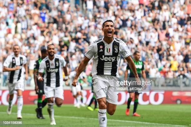 TOPSHOT Juventus' Portuguese forward Cristiano Ronaldo celebrates after scoring his first goal since he joined Juventus during the Italian Serie A...