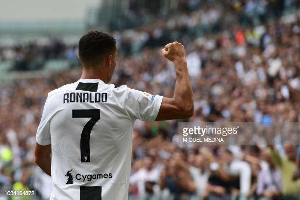 TOPSHOT Juventus' Portuguese forward Cristiano Ronaldo celebrates after scoring his second goal during the Italian Serie A football match Juventus vs...