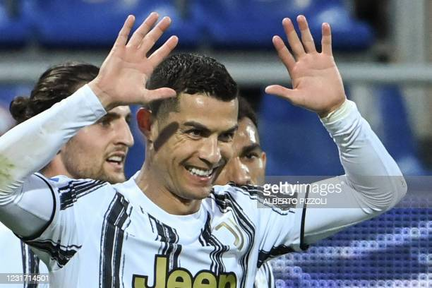 Juventus' Portuguese forward Cristiano Ronaldo celebrates after scoring his third goal during the Italian Serie A football match Cagliari vs Juventus...