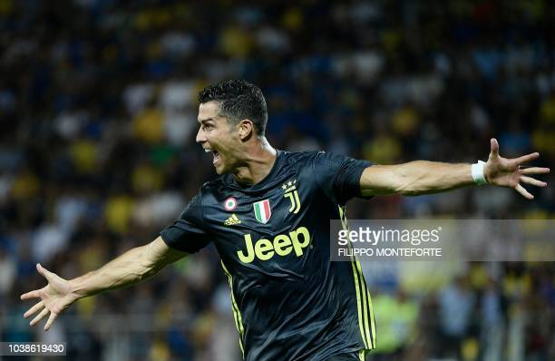 TOPSHOT Juventus' Portuguese forward Cristiano Ronaldo celebrates after scoring during the Italian Serie A football match between Frosinone and...
