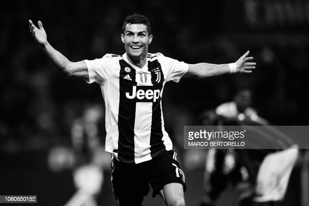 Juventus' Portuguese forward Cristiano Ronaldo celebrates after scoring during the Italian Serie A football match AC Milan vs Juventus on November 11...