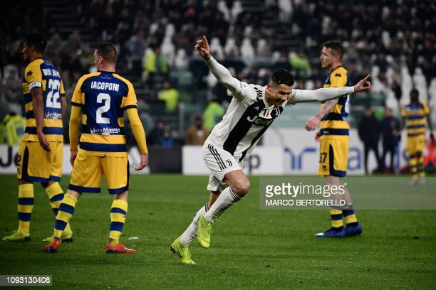 Juventus' Portuguese forward Cristiano Ronaldo celebrates after opening the scoring during the Italian Serie A football match Juventus vs Parma on...
