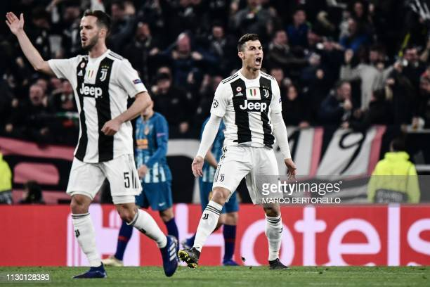 Juventus' Portuguese forward Cristiano Ronaldo celebrates after scoring during the UEFA Champions League round of 16 secondleg football match...