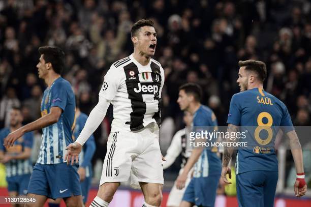 Juventus' Portuguese forward Cristiano Ronaldo celebrates after opening the scoring during the UEFA Champions League round of 16 secondleg football...