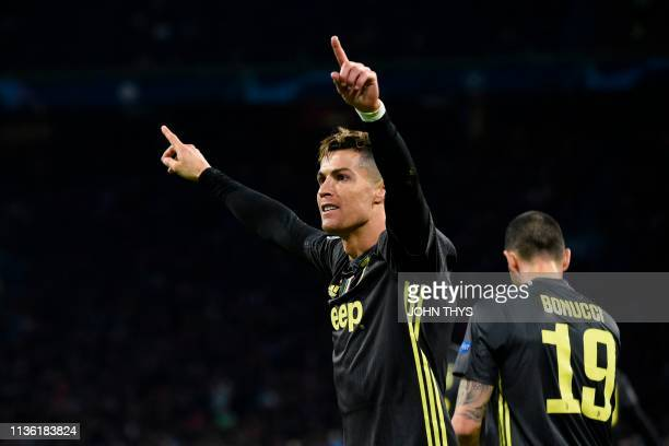 Juventus' Portuguese forward Cristiano Ronaldo celebrates after scoring the opening goal during the UEFA Champions League first leg quarterfinal...