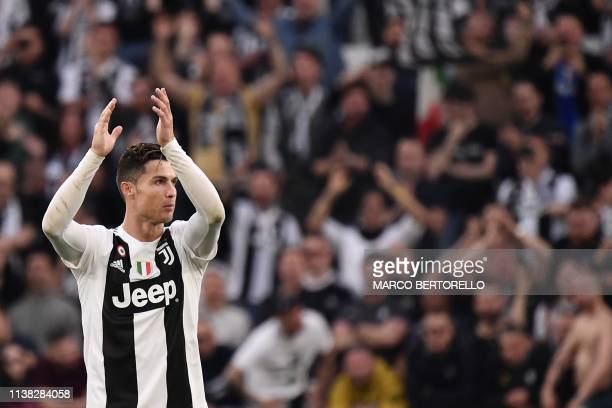 Juventus' Portuguese forward Cristiano Ronaldo celebrates after Juventus secured the Italian 2018/19 Scudetto Serie A championships after winning the...