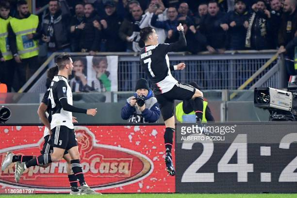 Juventus' Portuguese forward Cristiano Ronaldo celebrates after opening the scoring during the Italian Serie A football match lazio Rome vs Juventus...