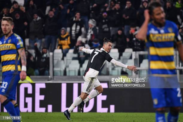 TOPSHOT Juventus' Portuguese forward Cristiano Ronaldo celebrates after opening the scoring during the Italian Serie A football match Juventus vs...