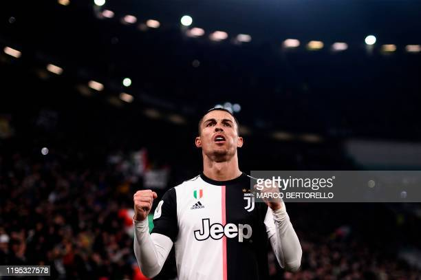 Juventus' Portuguese forward Cristiano Ronaldo celebrates after opening the scoring during the Italian Cup round of 8 football match Juventus vs AS...