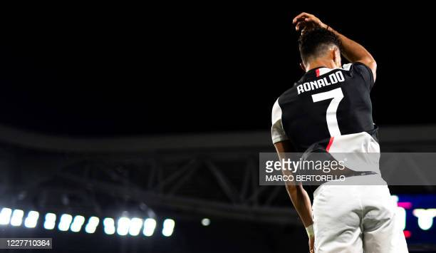 Juventus' Portuguese forward Cristiano Ronaldo celebrates after scoring the first goal during the Italian Serie A football match between Juventus and...