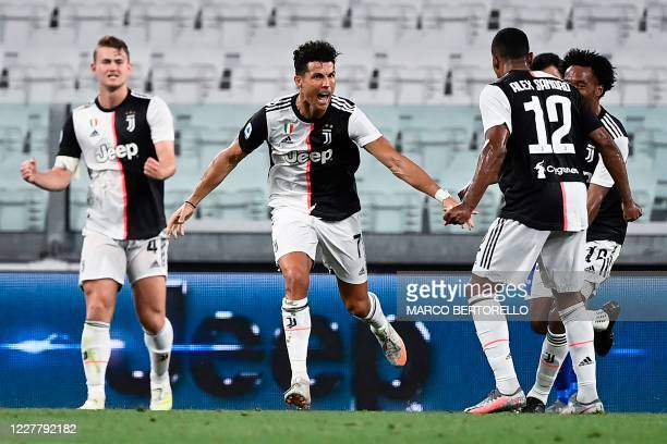 TOPSHOT Juventus' Portuguese forward Cristiano Ronaldo celebrates after scoring during the Italian Serie A football match between Juventus and...