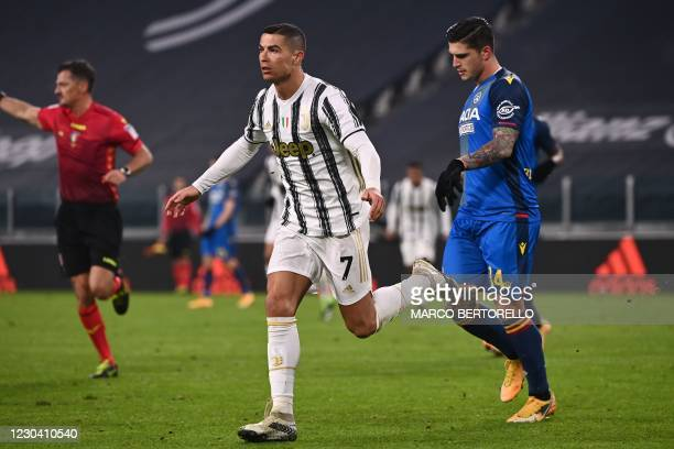Juventus' Portuguese forward Cristiano Ronaldo celebrates after opening the scoring during the Italian Serie A football match Juventus vs Udinese on...