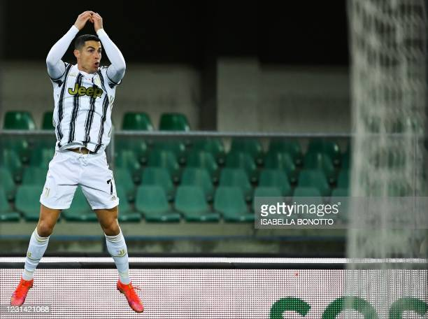 Juventus' Portuguese forward Cristiano Ronaldo celebrates after opening the scoring during the Italian Serie A football match Hellas Verona vs...