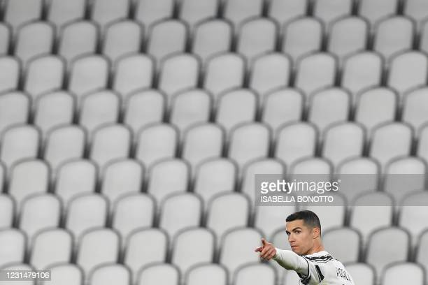 Juventus' Portuguese forward Cristiano Ronaldo celebrates after scoring the third goal during the Italian Serie A football match Juventus vs Spezia...