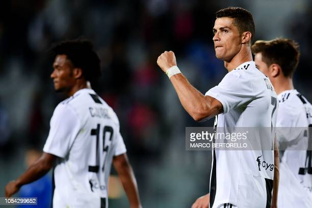 Juventus' Portuguese forward Cristiano Ronaldo celebrates at the end of the Italian Serie A football match between Empoli and Juventus on October 27...