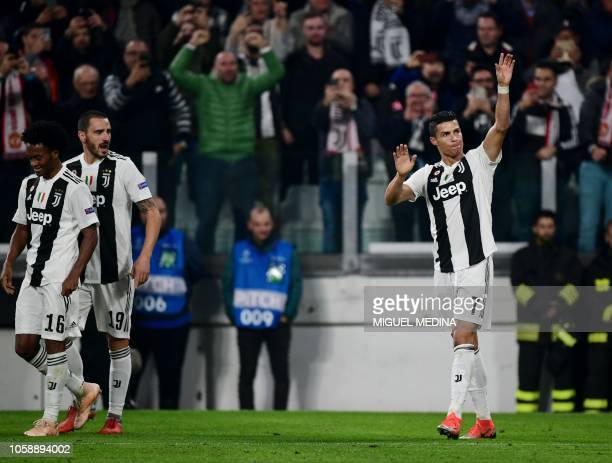 Juventus' Portuguese forward Cristiano Ronaldo celebrates next to Juventus' Colombian midfielder Juan Cuadrado and Juventus' Italian defender...