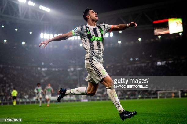 TOPSHOT Juventus' Portuguese forward Cristiano Ronaldo celebrates scoring his team's second goal during the Italian Serie A football match between...