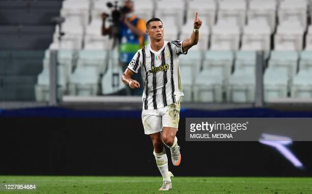 Juventus' Portuguese forward Cristiano Ronaldo celebrates scoring his team's first goal during the UEFA Champions League round of 16 second leg...
