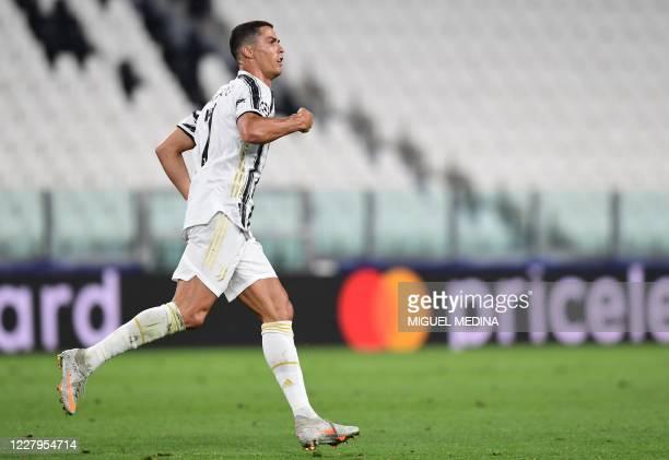 Juventus' Portuguese forward Cristiano Ronaldo celebrates scoring his team's second goal during the UEFA Champions League round of 16 second leg...