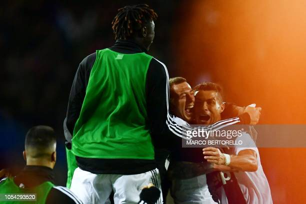 Juventus' Portuguese forward Cristiano Ronaldo celebrates with teammates after scoring a goal during the Italian Serie A football match between...