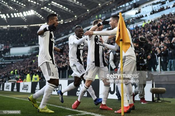 Juventus' Portuguese forward Cristiano Ronaldo celebrates with teammates after opening the scoring during the Italian Serie A football match Juventus...