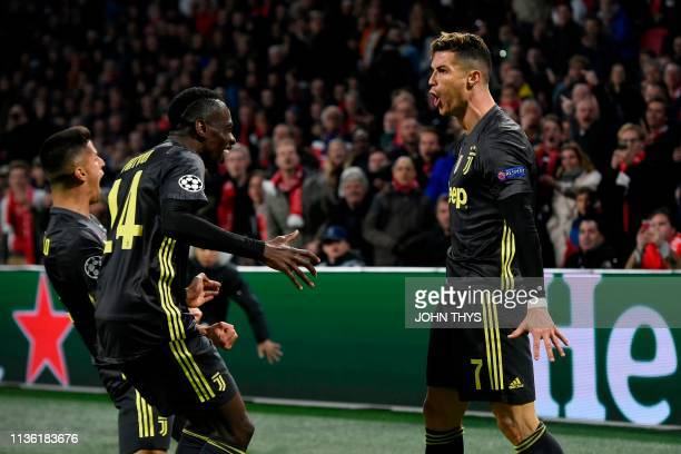 Juventus' Portuguese forward Cristiano Ronaldo celebrates with teammates after scoring a goal during the UEFA Champions League first leg...