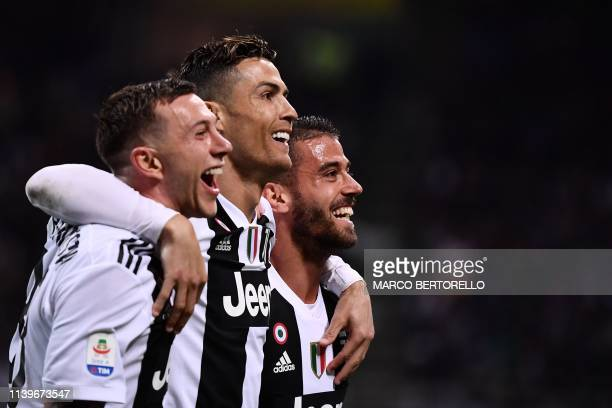 Juventus' Portuguese forward Cristiano Ronaldo celebrates with teammates after scoring a goal during the Italian Serie A football match between Inter...