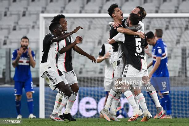 TOPSHOT Juventus' Portuguese forward Cristiano Ronaldo celebrates with teammates after scoring during the Italian Serie A football match between...