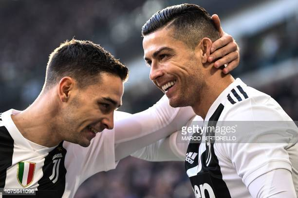 Juventus' Portuguese forward Cristiano Ronaldo celebrates with Juventus' Italian defender Mattia De Sciglio after opening the scoring during the...