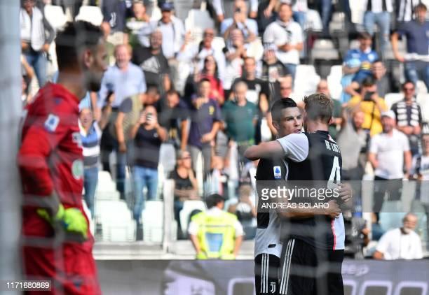 Juventus' Portuguese forward Cristiano Ronaldo celebrates with Juventus' Dutch defender Matthijs de Ligt after scoring against Spal's Albanian...
