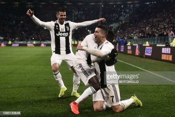 Juventus' Portuguese forward Cristiano Ronaldo celebrates with Juventus' French midfielder Blaise Matuidi and Juventus' Italian defender Leonardo...