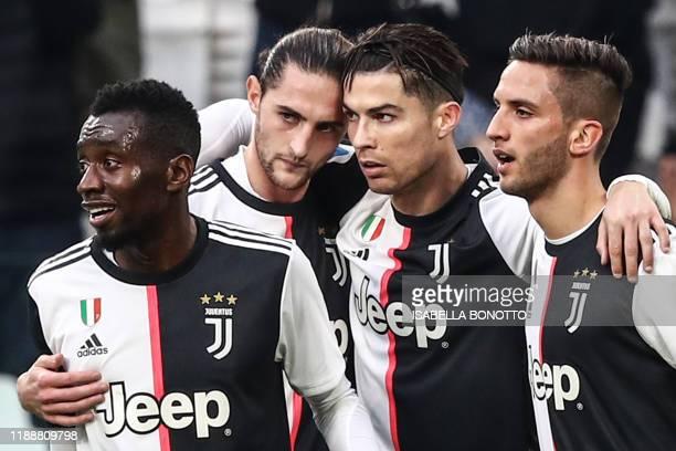 Juventus' Portuguese forward Cristiano Ronaldo celebrates with Juventus' French midfielder Blaise Matuidi Juventus' French midfielder Adrien Rabiot...