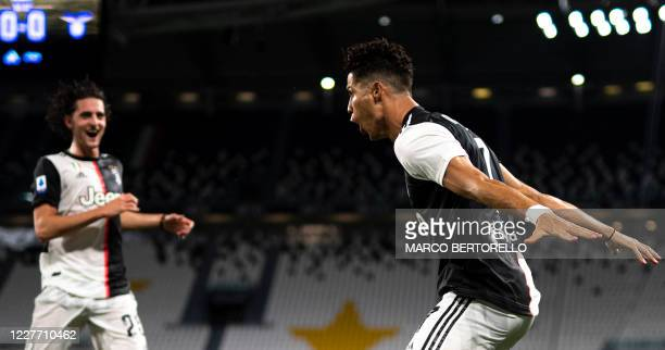 Juventus' Portuguese forward Cristiano Ronaldo celebrates with Juventus' French midfielder Adrien Rabiot after scoring the first goal during the...