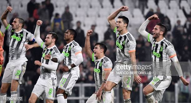 Juventus' Portuguese forward Cristiano Ronaldo celebrates with his teammates at the end of the Italian Serie A football match between Juventus and...