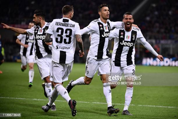 Juventus' Portuguese forward Cristiano Ronaldo celebrates with his teammates after scoring a goal during the Italian Serie A football match between...