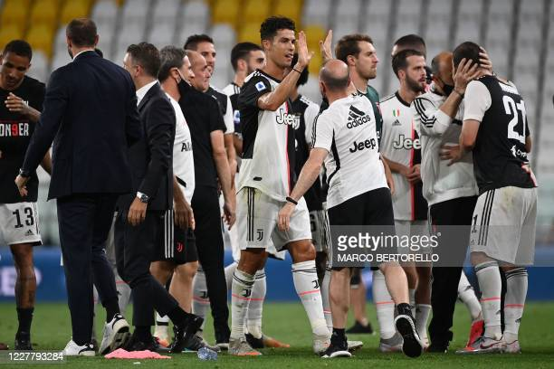Juventus' Portuguese forward Cristiano Ronaldo celebrates with his teammates the Serie A title after the Italian Serie A football match between...
