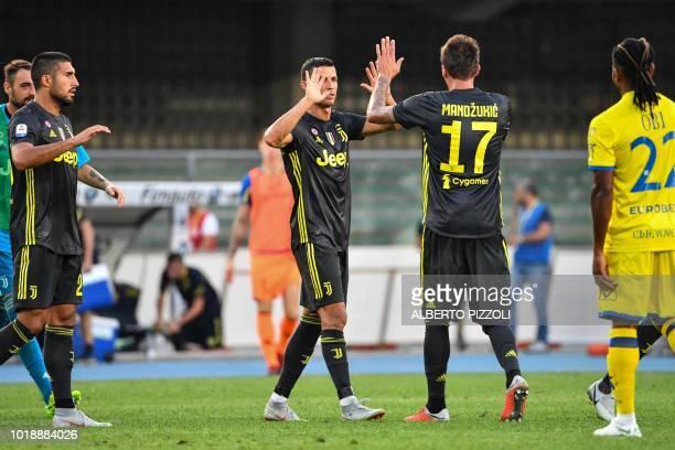Juventus' Portuguese forward Cristiano Ronaldo celebrates with Juventus' Croatian forward Mario Mandzukic after the Italian Serie A football match AC...