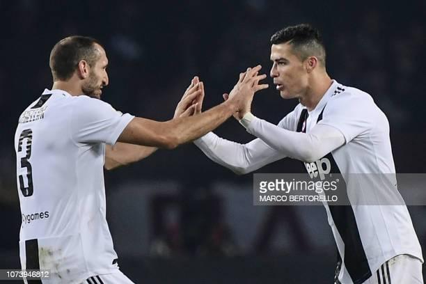 Juventus' Portuguese forward Cristiano Ronaldo celebrates with Juventus' Italian defender Giorgio Chiellini after opening the scoring during the...