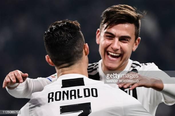 Juventus' Portuguese forward Cristiano Ronaldo celebrates with Juventus' Argentine forward Paulo Dybala after scoring during the Italian Serie A...