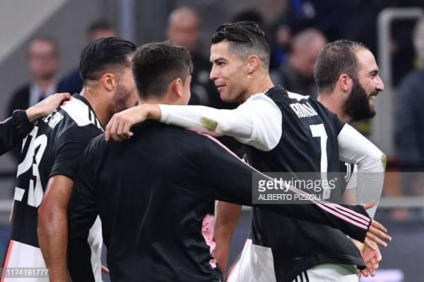 Juventus' Portuguese forward Cristiano Ronaldo celebrates with Juventus' Argentine forward Paulo Dybala and Juventus' Argentinian forward Gonzalo...