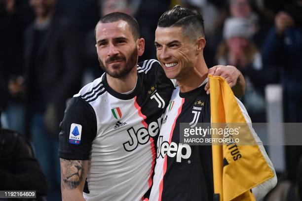 Juventus' Portuguese forward Cristiano Ronaldo celebrates with Juventus' Italian defender Leonardo Bonucci after scoring a penalty during the Italian...